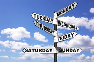 street sign with days of the week